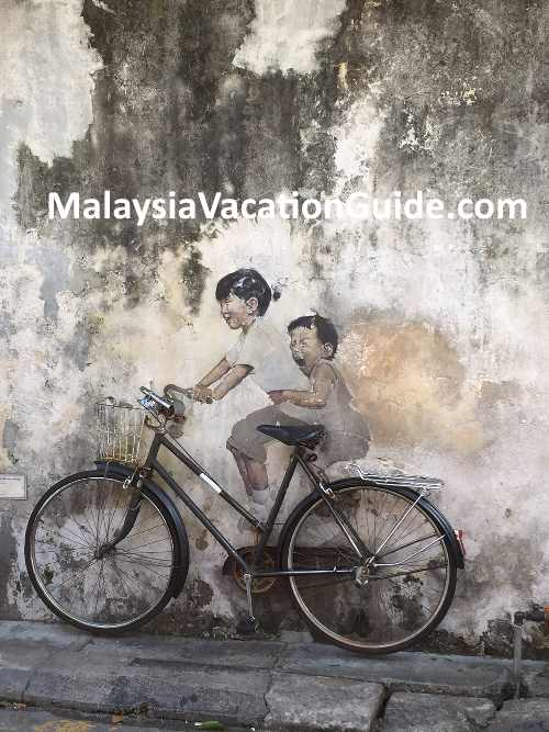 kids on bicycle penang lebuh armenian